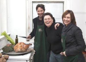 Rev. Ann Kansfield, co-pastor of Greenpoint Reformed Church, works in the soup kitchen with actors Keanu Reeves and Vera Farmiga who dropped by to serve in 2009. (Photo credit: Philip Mauro Thursday, November 26, 2009)