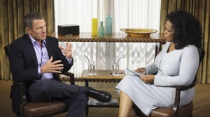 Lance Armstrong speaks with Oprah Winfrey during taping for the show Oprah and Lance Armstrong: The Worldwide Exclusive in Austin, Texas, on Monday. The interview airs Thursday and Friday on the Oprah Winfrey Network. (George Burns/AP)